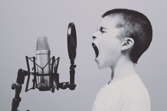 child singing in front of mic.jpg